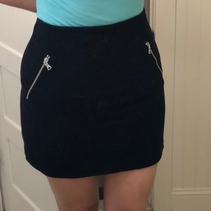 Black skirt with silver zippered side pockets
